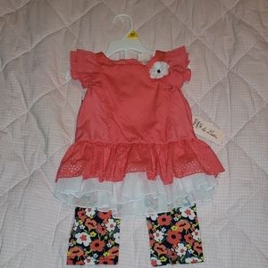 Two piece floral capri and pink ruffle shirt set